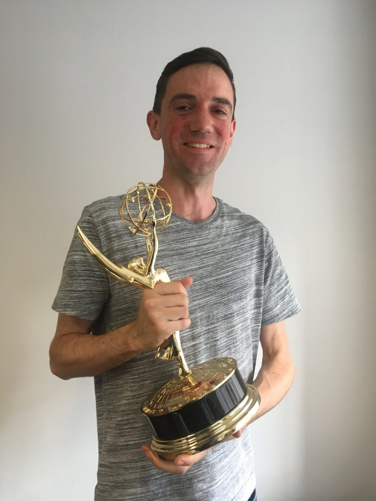 Me with a shiny award. No I don't get to keep it. Stay outta my home! :P